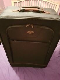 A pair of matching suit cases £40.