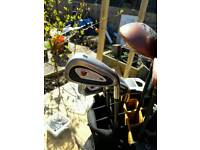 Golf clubs and trolly bag