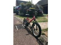 Small red and black superhero bike