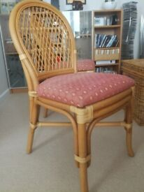 2 wicker chairs with padded seats