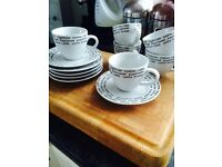 SET OF 6 WHITE CUPS + SAUCERS WITH PRINT WRITING ALL ROUND THE CUPS + SAUCERS