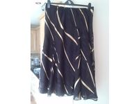 LADIES SORRENTO SKIRT SIZE 20, BLACK WITH GOLD STRIPES, EXC. COND
