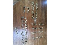 Set decorative brass wardrobe,cupboard and chest of drawer handles, with matching screws