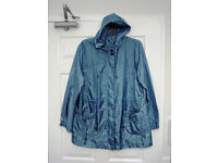Two G' lightweight raincoats size 20, blue patterned and plain purple