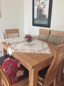 Extending wooden table and 6 chairs