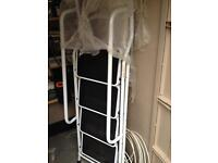 New 4 tier step ladder with hand rails very sturdy.