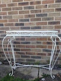 Wrought iron glass-topped table