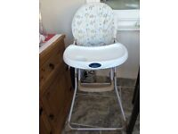 BabyStart Folding Highchair. Unisex design with tray & safety harness, folds flat for easy storage