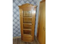 Tall glass fronted bookcase/display cabinet - Pine