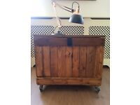 Rustic wooden storage trunk/coffee table/bar chest. NEW Handcrafted. Locking wheels. LOCAL DELIVERY.