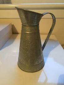 Silver vintage style watering can