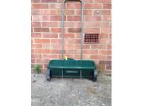 Grass seed spreaders