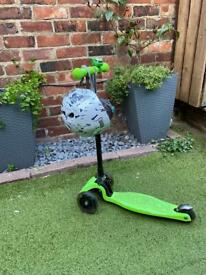Medium green scooter and helmet
