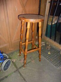 Tall wooden stool.
