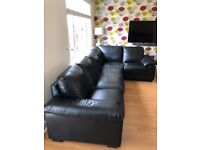 Dark brown corner couch with matching foot stool