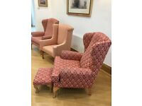 Three upholstered wing chairs
