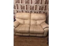 Two Cream Leather Reclining Sofas