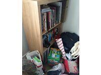 Desk, bookcase and crime / football books
