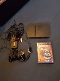 Ps2 console with 1 contols, and 1 game