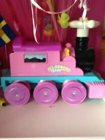 Pink ride on electric train and add on cargo pull along