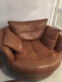 Tan leather round cuddler arm chair