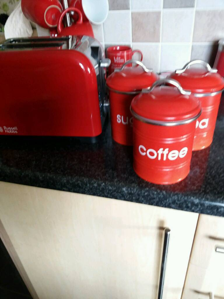 Red Russell Hobbs 2 slice toaster and tea sugar coffee cannisters