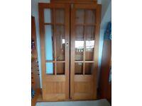 Double, wooden, glazed internal doors.