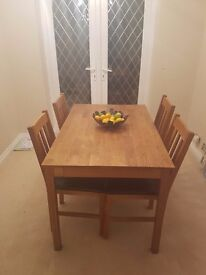 Julian bowen small solid oak table and four chairs