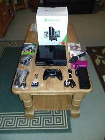 XBOX 360 250gb + on board games & 2 discs.