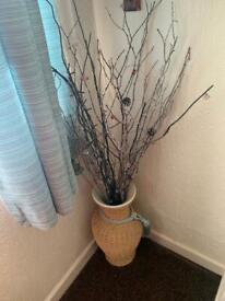 Decorational twigs with wicker vase