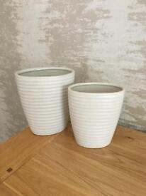 Pair of cream vases