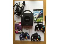 Nintendo Gamecube Console with 3 controllers and a game