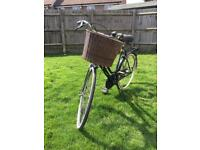 Traditional ladies dutch style bike with basket