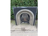 Solid Mahogany mantle piece, cast iron instead with the bars. Black Granite hearth.