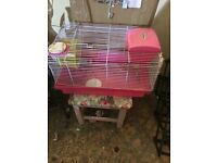 Pink hamster cage