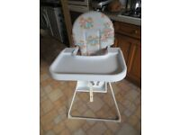 Folding high chair with detachable tray