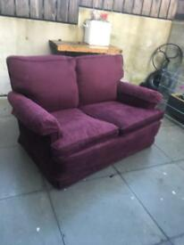 Maroon coloured sofa