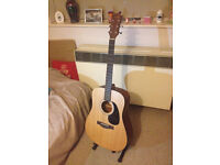 Marina acoustic guitar in excellent condition with Ready Ace stand