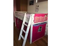 A mid-sleeper bed that has been used three years. In very good state and includes mattress.