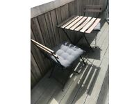 Garden table & 2 chairs with cushions