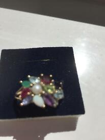 11 precious stone gold ring
