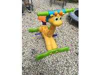 Giraffe child's toy with pedals