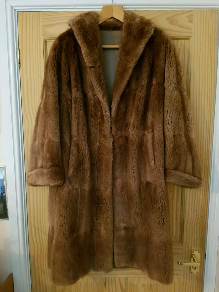 Musquash fur coat. Size 16.