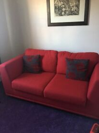 Red 2 seater sofa bed for sale, immaculate, hardly used