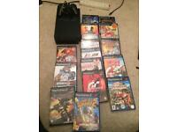 Black Sony Ps2 console and games