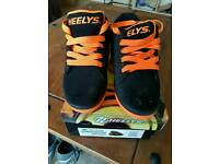 TWO , yes TWO pairs of genuine Heelys - see for details