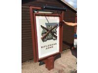 Swinging pub sign