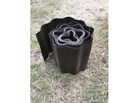 Roll of plastic lawn edging