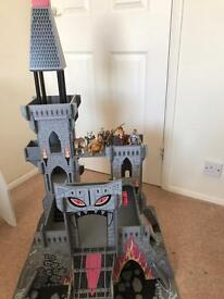 Wooden castle with play figures