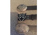 Superhero belts all medium (32 -34 waist) 1 superman, 1 transformers and 1 batman large buckle.